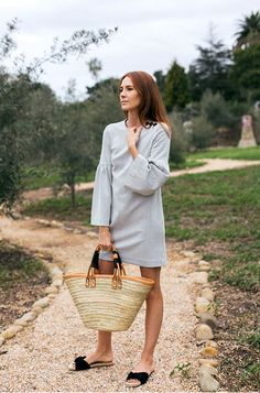 We are obsessed with this straw tote bag we spotted on Could I Have That.