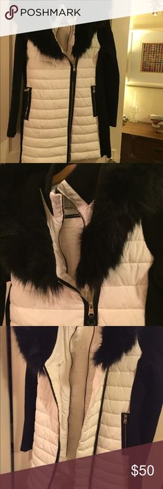 Calvin Klein winter coat with fur trim Gorgeous yet functional this designer coat is very versatile. Inner and outer zippers featured as well as fur trim on the hood which zips open to lay flat. Been too warm to wear so selling it. Bought this year and wore once. Calvin Klein Jackets & Coats