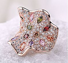 Make a boldly feminine statement with this beautiful unique ring handcrafted with intricate, and a flawless finish. -18K Gold Plated -Austria bright colorful crystals.
