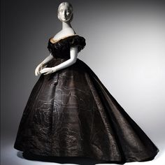 """Death Becomes Her: A Century of Mourning Attire,"" The Costume Institute's first fall exhibition in seven years, will be on view from October 21, 2014 through February 1, 2015. The exhibition will explore the aesthetic development and cultural implications of mourning fashions of the 19th and early 20th centuries. Evening Dress, ca. 1861. Lent by Roy Langford. #metmuseum #DeathBecomesHer"