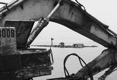 Photography   Jacob Cartwright  Earth mover framing a floating fish farm in the Mo Tat Wan Bay, Lamma Island, Hong Kong