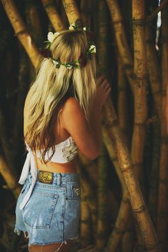 3 things I'm obsessed with. Floral crowns, crop tops, and high waisted denim shorts:)
