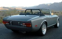 Fiat Spider. I don't usually like the roll bar and no bumper, but this looks pretty nice.