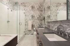 Just off the master bedroom is a marble bath with double sinks and a separate stall shower and tub. oliia wilde & jason s nyc loft