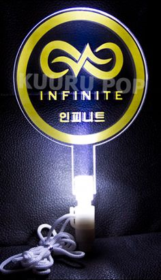 INFINITE Light Stick  Show your love for INFINITE with this awesome light stick! This particular light stick is printed with 'INFINITE' and their name in Hangul - 인피니트. It glows a bright white.  - Light stick is 18.5 cm / 7 inches long and measures 10.5 cm / 4 inches at the widest point. - Powered by 3 LR44 batteries (included). These can easily be replaced by unscrewing the base should they run down.