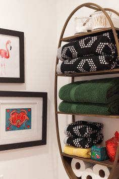 The oval towel storage was found at World Market.