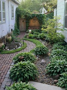 A neat garden. The old wooden door and its wall are ivy covered. Notice how the path does not change paver direction in the curve. As though the path was wider and they cut the curve out leaving the grain. Low maintenance with rock covering and shade plants. '38 Garden Design Ideas'