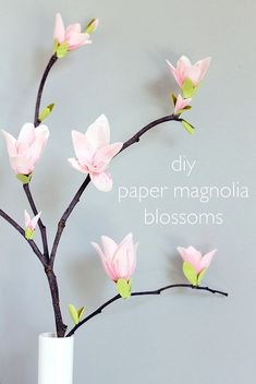 diy magnolia blossoms. so pretty for a large scale centerpiece or entry hallway. Turn these blossoms into a mobile too!