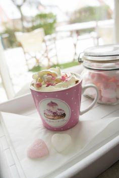 Hot chocolate with heart shaped sugar and whipped cream..