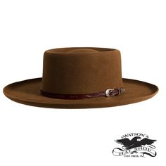 "Inspired by the cowboys in Florida and some of the first cattle ranchers in the US. Shown in 50% Beaver Blend and 50% Rabbit Fur Felt. Color: Adobe Crown: Telescopic 4"" Brim: 4"" Flat with Roll Hat Band: Hand carved 5/8 leather with scalloped designed buckle (Mahogany color)"