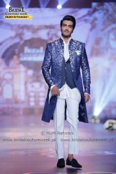 """AMIR ADNAN BRIDAL COLLECTION AT BRIDAL COUTURE WEEK GOLD '16 Representing threads of history and monarchy, Amir Adnan is showcasing his """"Ceremony Collection"""" at Bridal Couture Week 2016. The collection encapsulates statement jackets and sherwanis paired with Jodhpur-eque pajamas and gathered, tucked and rumpled luxurious shalwars. The collection is a tasteful ode to classical tailoring and royal romance that is communicated through its bright game of tones. Amir Adnan's coll... Mens Sherwani, Indian Groom Wear, Modern Gentleman, Couture Week, Jodhpur, Groom Dress, Bridal Collection, Mens Suits, Statement Jackets"""