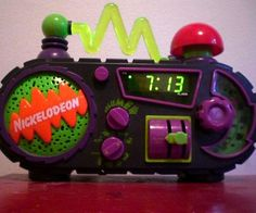 """Wouldn't mind waking up to this! The Nickelodeon Timeblaster Alarm Clock alarm clock features a green zig-zag light and a radio. One of the alarm options is the Nickelodeon theme, """"Nick Nick Nick Nick, N-Nick Nick Nick, Nickelodeon!"""" How awesome is that!?"""