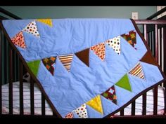 Simple crib quilt for beginners.Learn how to sew a cute baby quilt with an appliqué pennant bunting. Video tutorial by Made by Marzipan ...