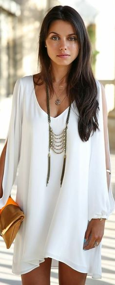 Lovely white mini boho summer dress. Love the necklace, too.