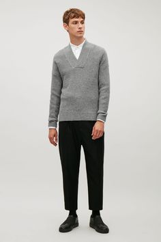 A casual design, this jumper is made from a heavy knit, pure wool with contrast coloured nep texture. A straight fit and a relaxed style, it has an overlapping v-neckline, dropped shoulders and clean, minimal edges.