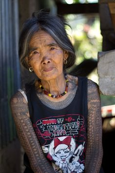 """""""The Last Kalinga Tattoo Artist"""". A fascinating culture of the Igorot people brought me and my girlfriend to Kalinga. Head-hunting ceased decades ago, however, the motifs of Kalinga tattoos and the way they are being tattoed remains the same (charcoal and an orange thorn). We decided to visit this beautiful tribeswoman who is the last Kalinga tattoo artist. After a few days, long hours spent on buses and jeepneys, we were lucky to find a local guide Francis who brought us to Buscalan. We…"""