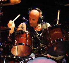"""Kenny Aronoff. Solid grooves packed with power & energy. Popularized the sound of a wide open snare drum again with John """"Cougar"""" Mellencamp's """"Uh Huh"""" album. Goodbye to duct tape!"""