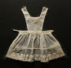 """Stephanie Metz -Apron, Felted wool, found clothing,23"""" x 31"""" x 2"""",2009"""