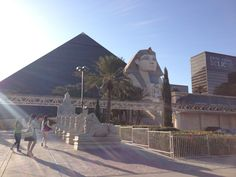 """Luxor Hotel & Casino in Las Vegas, NV """"No passport? No worries. The Las Vegas Strip's flashy parade of hotels-cum-casinos can take you around the world without credentials, from the Sphinx in front of the Luxor Hotel's grand black pyramid; to the half-scale copy of the Eiffel Tower at Paris Las Vegas; to the Big Apple skyline at New York-New York."""" - 1,000 Places to See Before You Die Calender, Thursday May 22, 2014"""