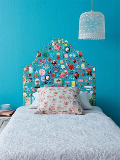 Create a headboard frame filled with pictures of your most favourite things