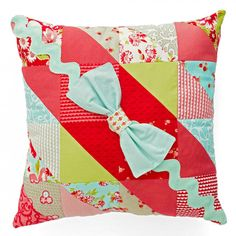 Combine a pack of charm squares and jumbo rickrack to make a stylish pillow. Fabrics are from the Ruby collection by Bonnie and Camille for Moda Fabrics.