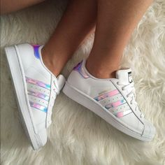 Pinterest: dopethemesz ; iridescent dreams; Adidas Superstar Holographic/Iridescent Sold out EVERYWHERE! I stalked Amazon to get these  finally did! I dont wear them nearly as much as I though that I would, so Im thinking of selling. Accepting offers to see what I can get for them! Kids size 4.5 which is a Womens size 6/6.5. These are amazing shoes, I call them my unicorn shoes also on M e r c Adidas Shoes