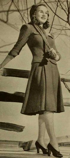 Deanna Durbin poses in 1940s College fashions. 1. 1940′s Day-Suit - two part triumph of soft green cashmere-jersey with bright-red knitted sleeves and stocking cap. Push up sleeves are a college requirement. The knitted stocking cap that twirls into a scarf is destined to be a big campus fad this Autumn season