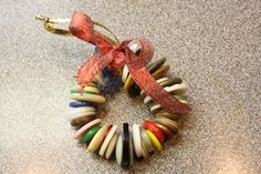 easy Christmas button wreath ornament for kids to make using buttons and pipe cleaner! from Happy Hooligans blog