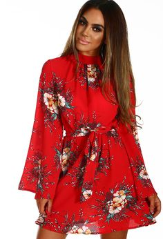 Step into spring with a wardrobe update; this red floral mini dress is a beaut! In a crepe fabric, this red mini dress features an all over floral print, long flared sleeves and a tie waist. Fastening with a concealed zip at the back, team this flare slee