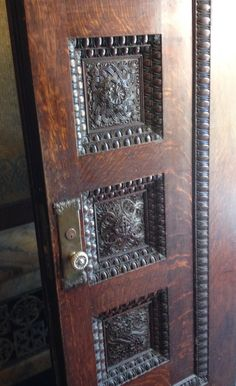 Detail of the inner vestibule double-doors to the [Entrance] Hall. I love the brass Victorian mortise-style door knobs with floral friezes and the door panels with the egg and dart molding. Notice that the Escutcheon plate is even carved. | James J. Hill House