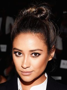 Shay Mitchell sported a twisted topknot and a daytime-appropriate smoky eye.