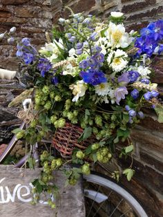 Blue and white wedding flowers in a vintage bicycle basket
