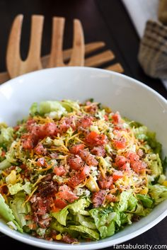 BEST Side Salad Recipe: chopped lettuce with dried basil and garlic powder sprinkled on.