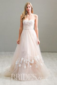 Brides.com: . Blush tulle A-line dress with a sweetheart neckline and floral embellishments, Jim Hjelm