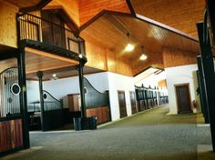 I would love a house built into a barn with a balcony opening to the inside to hear the horses