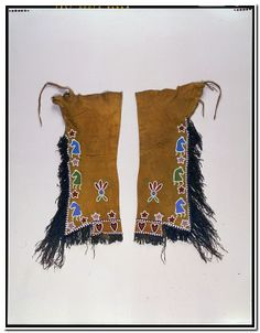 Man's leggings: possibly Oto or Kaw (attributed); collected from the Osage :  Date created:  circa 1900 Place:  Oklahoma; USA Media/Materials:  Hide, glass bead/beads, metal tacks/bosses, pigment/pigments, cotton thread Techniques:  Sewn, overlay beadwork, painte