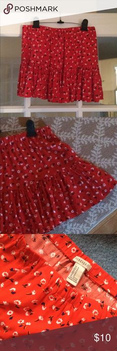 Red tiered skirt from F21. Great condition. Elastic waistband, rayon. white, blue, and yellow flower pattern. Forever 21 Skirts Mini