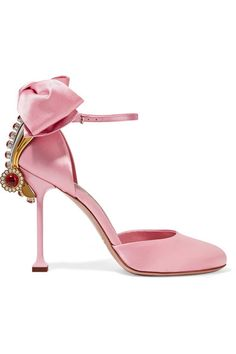 Crafted from lustrous baby-pink satin, Miu Miu's statement pumps were first spotted on the Fall '16 runway. Set on a sculptural stiletto heel, this feminine pair is finished with an oversized bow, Art Deco-inspired hardware and striking crystal embellishments. Pare them back by styling yours with faded jeans.