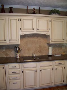 Cream Cabinets with dark brown glaze.