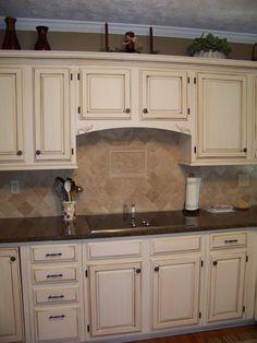 Cream Cabinets with dark brown glaze.
