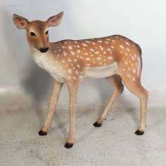 """Fawn from our Heimex Portraits of Animals.  This Life SizeFawn constructed of fiberglass and painted by hand, this Fawn statue is light enough to move yet strong enough for outdoor use.  Size: L 32.50"""" W11"""" H31.50"""" Weight 12 lbs. Fiberglass construction Indoor or outdoor use (see Product Care for outdoor use) Shipping weight: 22 lbs Christmas Yard, Christmas Night, Dog Garden Statues, Life Size Statues, Animal Statues, Studio Lighting, Outdoor Christmas Decorations, Toy Soldiers, Studio Portraits"""