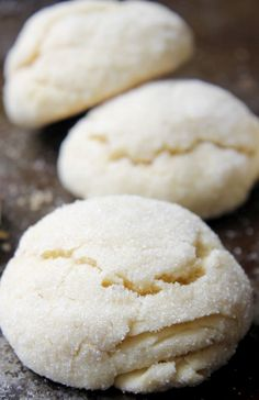"""Lemon Pillow Cookies The texture of these is unlike most cookies: somewhat light with a crisp exterior thats crusted in sugar. It called """"pillow cookies"""" because of their fluffy, pillow-like look thanks to baking powder. The lemon flavor is light, just Lemon Desserts, Lemon Recipes, Cookie Desserts, Just Desserts, Baking Recipes, Sweet Recipes, Cookie Recipes, Dessert Recipes, Cooking Cookies"""