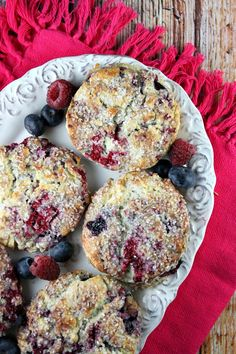 Berry Scones #recipe - RecipeGirl.com - a tender breakfast scone with raspberries and blueberries.