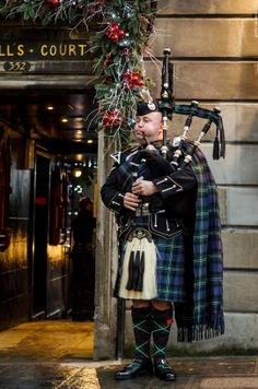 Piper during the Christmas season ~ Edinburgh, Scotland Oh tartan and bagpipes and holly and berries Christmas at home @ Deedidit D. Christmas In Scotland, Men In Kilts, Kilt Men, Famous Castles, England And Scotland, Perth, Scotland Travel, Ireland Travel, Scottish Highlands