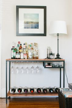 Bar cart Ikea hack -- I wonder if I could cover the black bits with copper mylar tape!