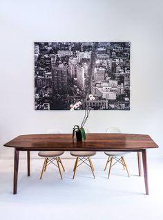 Our best selling table. Classic midcentury modern lines, married with crisp modern details in 100% solid black american walnut. See what our amazing