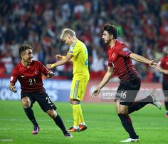 Ozan Tufan (R) and Emre Mor (L) of Turkey celebrate after scoring a goal during the UEFA 2018 World Cup Qualifying match between Turkey and Ukraine at Konya Metropolitan Municipality Stadium in Konya, Turkey on October 06, 2016. He scored from the penalty spot in the 81st minute to level the scores at 2-2.
