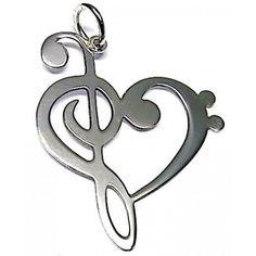 Colgante de plata de primera ley con forma de corazón formado por una clave de sol y una clave de fa. Dimensiones: 3,5 cm de largo por 2,7 cm de ancho