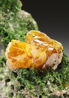 Wulfenite crystals situated upon a matrix rich in green Duftite microcrystals. Tsumeb Mine Otjikoto Region Namibia