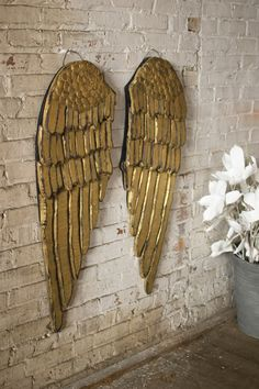 set of two painted wooden angel wings  $159.00      from awe at the west end-- great idea
